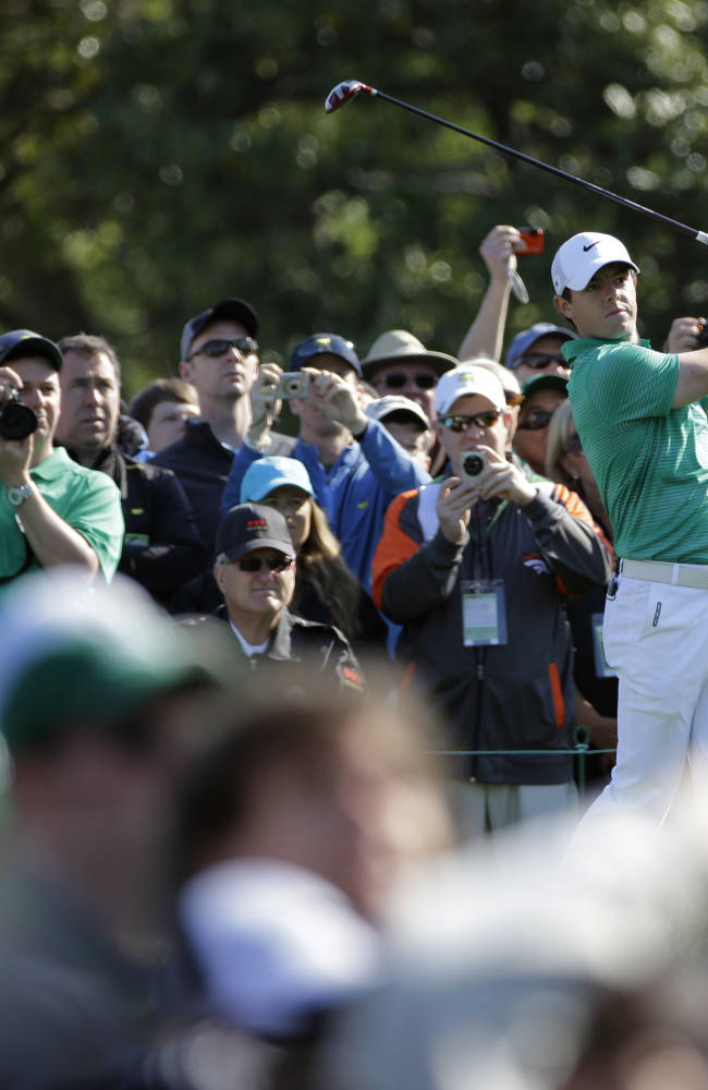 Rory McIlroy, of Northern Ireland, tees off on the 10th hole during a practice round for the Masters golf tournament Wednesday, April 9, 2014, in Augusta, Ga. (AP Photo/David J. Phillip)