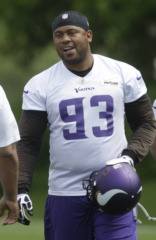 In this June 20, 2013 file photo, Minnesota Vikings defensive tackle Kevin Williams (93) in a Vikings' NFL football mini-camp in Eden Prairie, Minn. Without Williams in the middle, the Minnesota Vikings defense was powerless to stop Reggie Bush and the Detroit Lions last Sunday, Sept. 8, 2013. They hope to have Williams back this week at Chicago