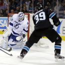 Tampa Bay Lightning goalie Anders Lindback, of Sweden, stops a shot from San Jose Sharks' Logan Couture (39) during the first period of an NHL hockey game on Thursday, Nov. 21, 2013, in San Jose, Calif The Associated Press
