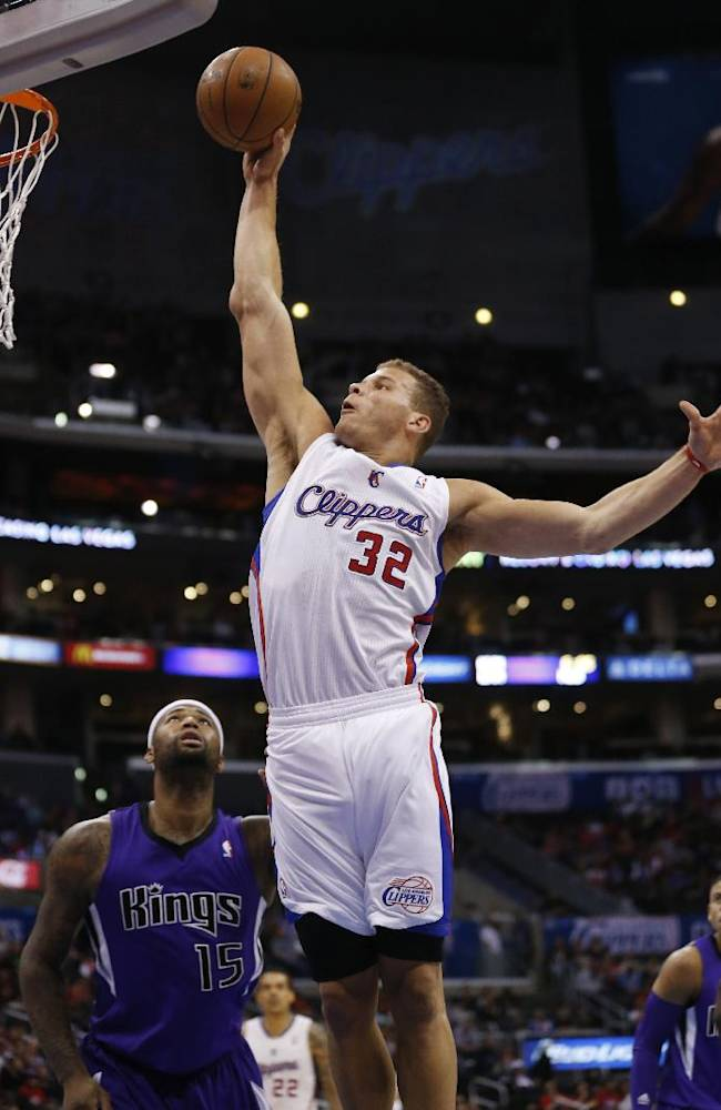 Los Angeles Clippers forward Blake Griffin dunks the ball over Sacramento Kings center DeMarcus Cousins during the first half of an NBA basketball game in Los Angeles, Sunday, April 12, 2014