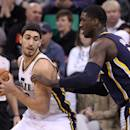 Indiana Pacers' Roy Hibbert, right, defends against Utah Jazz's Enes Kanter, left, of Turkey, in the first quarter during an NBA basketball game Wednesday, Dec. 4, 2013, in Salt Lake City. (AP Photo/Rick Bowmer)