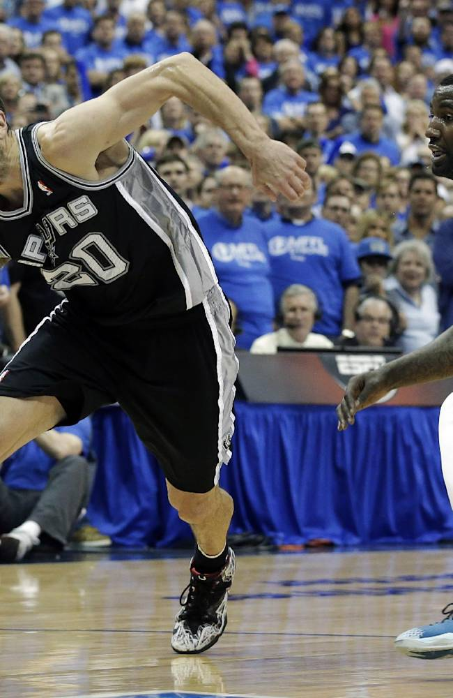 San Antonio Spurs' Manu Ginobili (20), of Argentina, loses control of the ball as Dallas Mavericks' DeJuan Blair (45) defends in the second half of Game 6 of an NBA basketball first-round playoff series on Friday, May 2, 2014, in Dallas. The Mavericks won 113-111