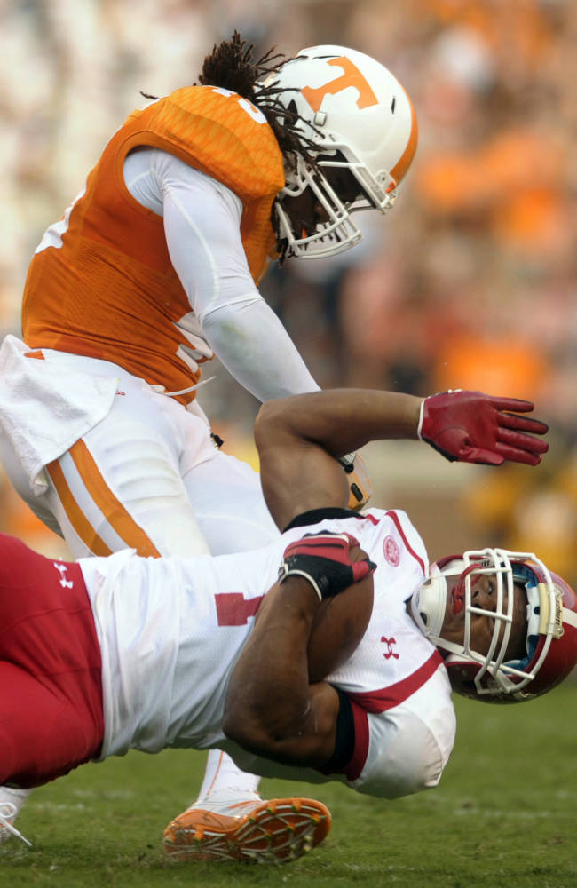 In an Aug. 31, 2013, photo Tennessee linebacker A.J. Johnson tackles Austin Peay wide receiver Rashaan Coleman during a football game in Knoxville, Tenn. Since entering the Tennessee  starting lineup as a freshman three years ago, Johnson has developed into an all-Southeastern Conference linebacker