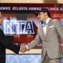 NBA Commissioner David Stern, left, shakes hands with Miami's Shane Larkin, who was selected by the Atlanta Hawks in the first round of the NBA basketball draft, Thursday, June 27, 2013, in New York. (AP Photo/Kathy Willens)