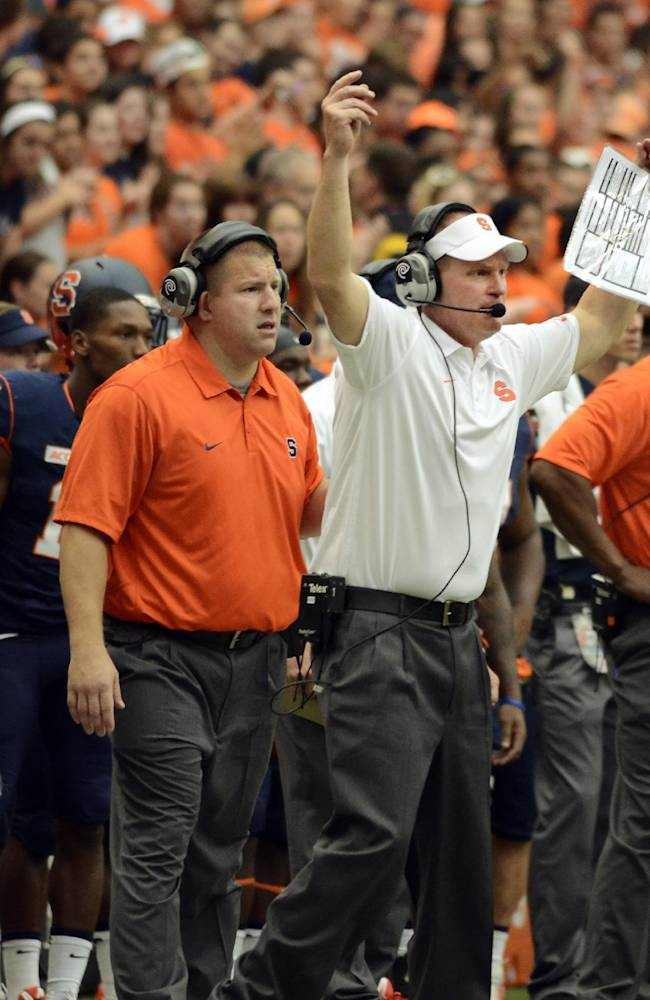 Syracuse head coach Scott Shafer, center, gestures on the sidelines during an NCAA college football game agains Tulane at the Carrier Dome in Syracuse, N.Y., Saturday, Sept. 21, 2013