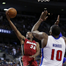 Miami Heat guard Norris Cole (30) shoots against Detroit Pistons center Greg Monroe (10) during the second half of an NBA basketball game on Friday, March 28, 2014, in Auburn Hills, Mich. The Heat defeated the Pistons 110-78 The Associated Press