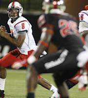 Louisiana-Lafayette quarterback Terrance Broadway (8) rolls out to throw the ball during an NCAA college football game against the Western Kentucky at Houchens-Smith Stadium on Tuesday, Oct. 15, 2013, in Bowling Green, Ky. (AP Photo/Daily News, Alex Slitz)