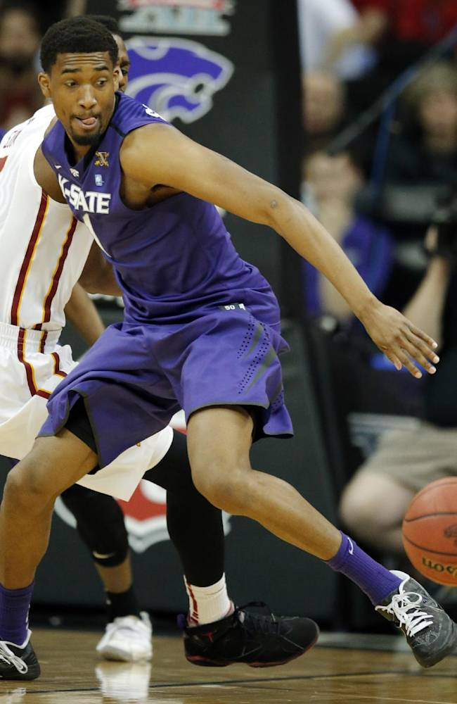 Kansas State guard Shane Southwell reaches for a loose ball during the first half of an NCAA college basketball game against Iowa State in the quarterfinals of the Big 12 Conference men's tournamentin Kansas City, Mo., Thursday, March 13, 2014