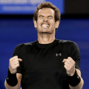 Andy Murray of Britain celebrates after defeating Tomas Berdych of the Czech Republic in their semifinal match at the Australian Open tennis championship in Melbourne, Australia, Thursday, Jan. 29, 2015. (AP Photo/Lee Jin-man)