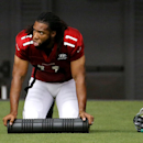 Arizona Cardinals' Larry Fitzgerald stretches during an NFL football training camp, Monday, July 28, 2014, in Glendale, Ariz The Associated Press
