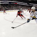 In a photo taken with a fisheye lens, Buffalo Sabres right wing Chris Stewart (80) skates against New Jersey Devils defenseman Jon Merrill (7) during the first period of an NHL hockey game, Tuesday, Jan. 6, 2015, in Newark, N.J The Associated Press