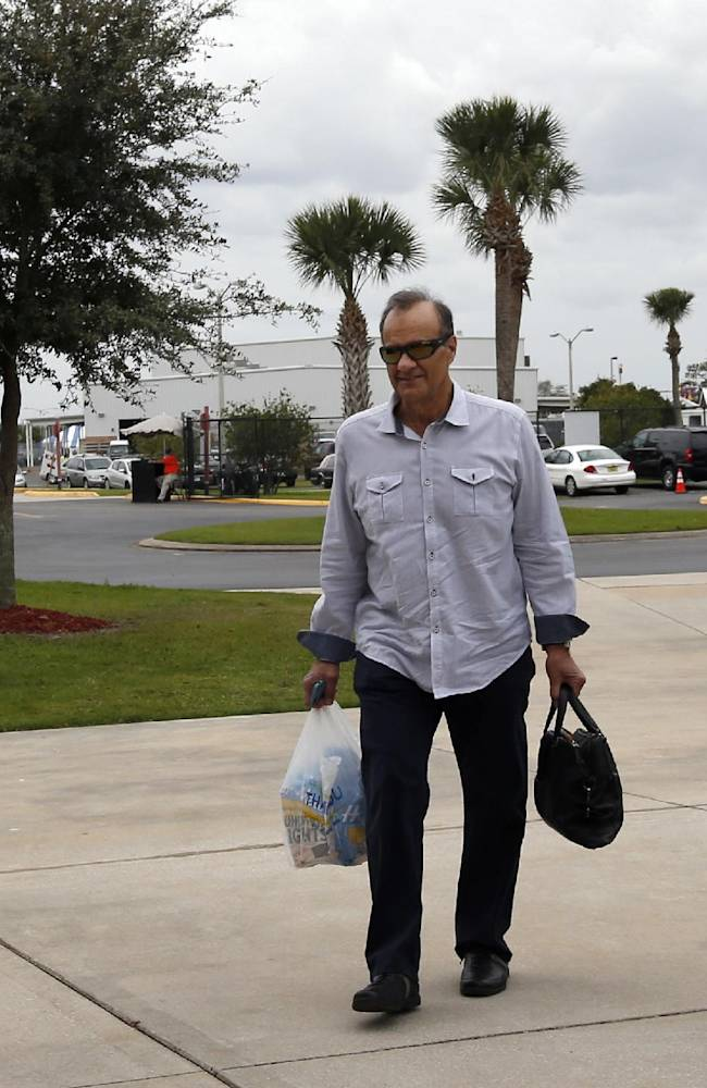Joe Torre, left, executive vice president of baseball operations for Major League Baseball, and others arrive for a meeting about the new instant replay rules, at the spring training facility for the Houston Astros, Friday, Feb. 21, 2014, in Kissimmee, Fla