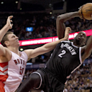 Brooklyn Nets forward Kevin Garnett (2) tries to shoot under heavy pressure from Toronto Raptors forward Tyler Hansbrough, left, during the second half of an NBA basketball game in Toronto on Tuesday, Nov. 26, 2013 The Associated Press