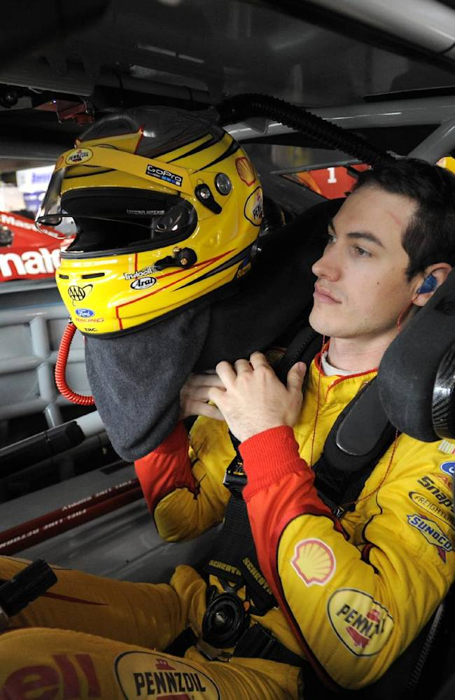 Sprint Cup driver Joey Logano prepares to go on the track during the first round of practice for a NASCAR auto race at Martinsville Speedway in Martinsville, Va., Friday March 28, 2014
