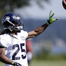 Seattle Seahawks' Richard Sherman tosses the ball during a drill at an NFL football camp practice on Saturday, July 26, 2014, in Renton, Wash The Associated Press