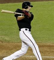 Arizona Diamondbacks' Patrick Corbin hits a three-run triple against the San Francisco Giants in the fourth inning of a baseball game, Sunday, Sept. 16, 2012, in Phoenix. (AP Photo/Ross D. Franklin)