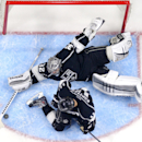 Los Angeles Kings goalie Jonathan Quick, top, stops a shot as center Anze Kopitar, of Slovenia, helps defend during the second period of an NHL hockey game against the New Jersey Devils, Wednesday, Jan. 14, 2015, in Los Angeles The Associated Press