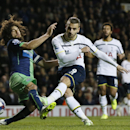 Tottenham's Roberto Soldado, right, shoots at goal under pressure from Newcastle United's Fabricio Coloccini during their English League Cup soccer quarterfinal match between Tottenham Hotspur and Newcastle United at White Hart Lane stadium in London Wedn