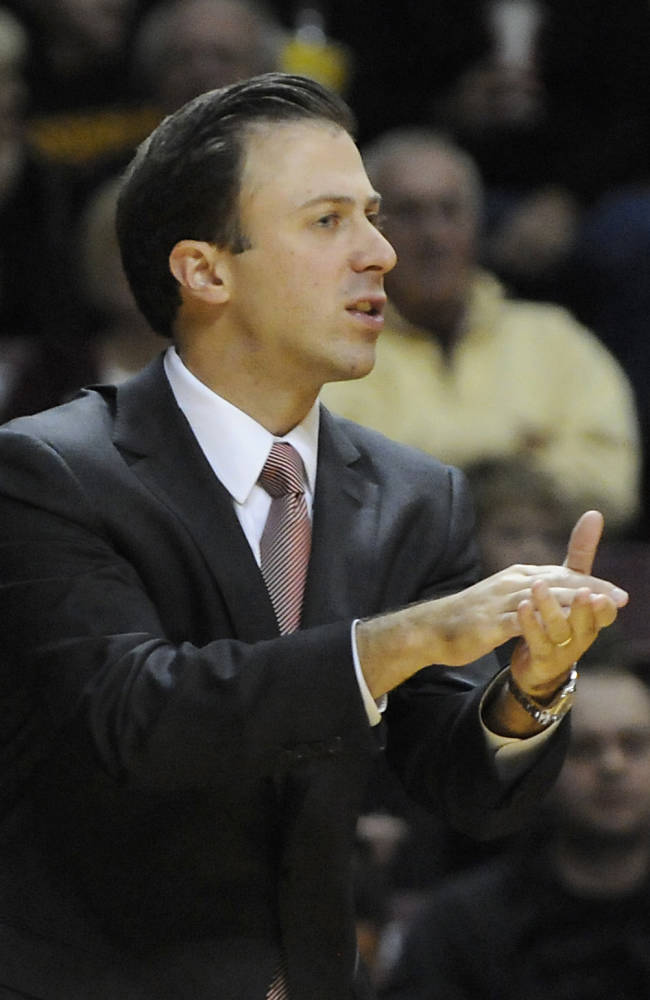FILe - In this Nov. 1, 2013 file photo, Minnesota coach Richard Pitino follows the action in the first half of an exhibition NCAA college basketball game against Cardinal Stritch in Minneapolis. The son of defending NCAA champion Louisville coach Rick Pitino, 31-year-old Richard moved to a six-year contract in the Big Ten after only one season as a head coach, going 18-14 at Florida International in the Sun Belt Conference