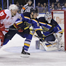 Detroit Red Wings' Niklas Kronwall (55) works against St. Louis Blues' Alexander Steen (20) for the puck in front of goalie Brian Elliott during the first period of an NHL hockey game, Thursday, Jan. 15, 2015, in St. Louis The Associated Press