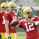 Green Bay Packers' Scott Tolzien, left, and Matt Flynn watch Aaron Rodgers throw during NFL football training camp Monday, July 28, 2014, in Green Bay, Wis The Associated Press