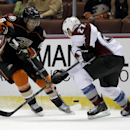 Anaheim Ducks right wing Emerson Etem, left, battles Colorado Avalanche defenseman Bruno Gervais for the puck during the second period of an NHL hockey preseason game in Anaheim, Calif., Monday, Sept. 22, 2014 The Associated Press