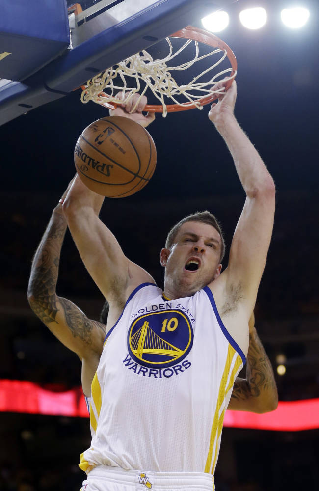 Golden State Warriors' David Lee dunks against the Los Angeles Clippers during the second half in Game 6 of an opening-round NBA basketball playoff series on Thursday, May 1, 2014, in Oakland, Calif. Golden State won 100-99
