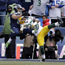 Green Bay Packers' Sam Shields intercepts a pass in front of Seattle Seahawks' Jermaine Kearse during the first half of the NFL football NFC Championship game Sunday, Jan. 18, 2015, in Seattle The Associated Press
