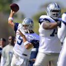 Dallas Cowboys quarterback Tony Romo (9) throws a pass as the offense runs a play during NFL training camp on Saturday, July 26, 2014, in Oxnard, Calif The Associated Press