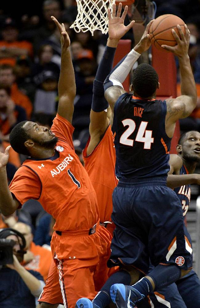Illinois guard Rayvonte Rice (24) shoots over teammate Maverick Morgan, right, and Auburn guard KT Harrell (1) in the first half of an NCAA college basketball game on Sunday, Dec. 8, 2013, in Atlanta