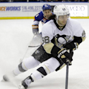 Pittsburgh Penguins' Kris Letang (58) looks to pass as he skates away from New York Islanders' Frans Nielsen (51) during the third period of an NHL hockey game Thursday, Jan. 23, 2014, in Uniondale, N.Y. The Penguins won the game 6-4 The Associated Press