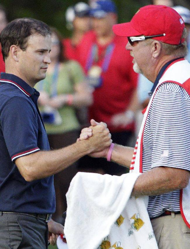 US leads by 1 after crazy day at Presidents Cup