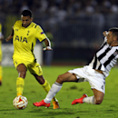 Tottenham Hotspur's Aaron Lennon, center, avoids a tackle from Partizan Belgrade's Miroslav Vulicevic, right, during the Europa League Group C soccer match between Partizan Belgrade and Tottenham Hotspur in Belgrade, Serbia, Thursday, Sept. 18, 2014