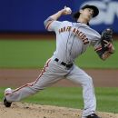 San Francisco Giants starting pitcher Tim Lincecum throws against the New York Mets in the first inning of the first game of baseball doubleheader Monday, April 23, 2012, in New York. (AP Photo/Kathy Kmonicek)