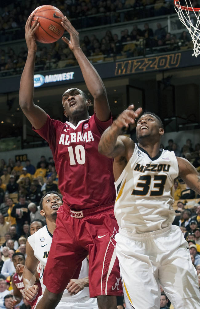 Alabama's Jimmie Taylor (10) pulls down a rebound over Missouri's Earnest Ross, right, as Johnathan Williams, III left, looks on during the second half of an NCAA college basketball game, Saturday, Jan. 18, 2014, in Columbia, Mo. Missouri won the game 68-47