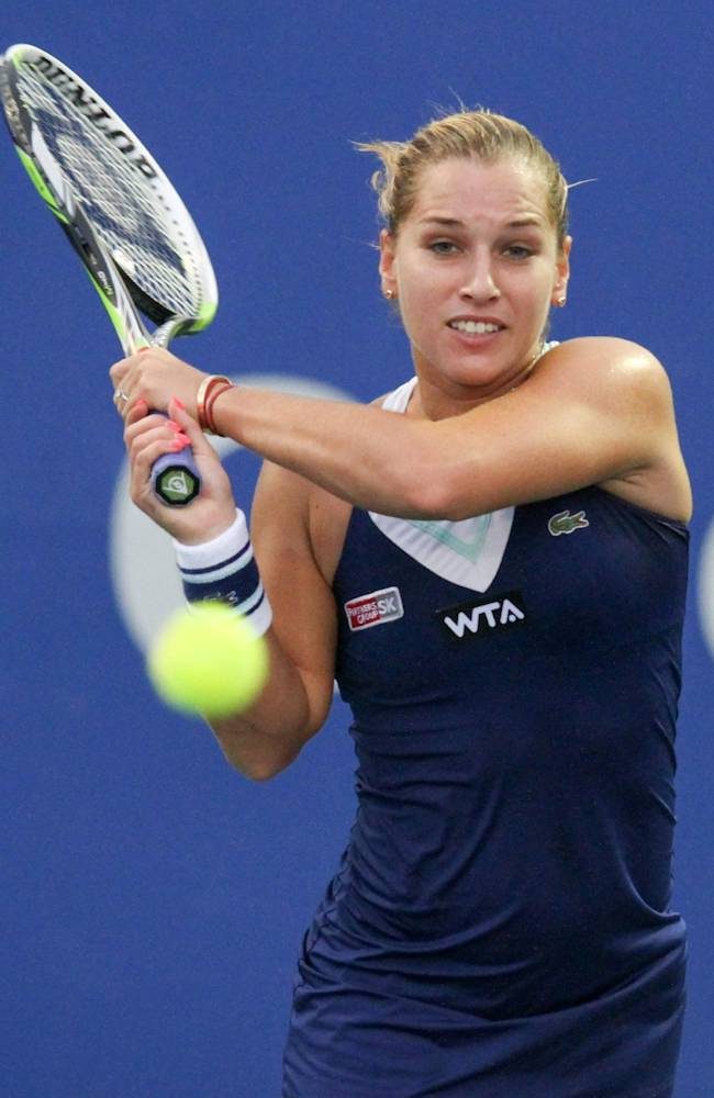 Dominika Cibulkova of Slovakia returns a shot against Pemra Ozgen of Turkey during their first round match at the WTA Malaysian Open tennis tournament in Kuala Lumpur, Malaysia, Wednesday, April 16, 2014. (AP Photo)