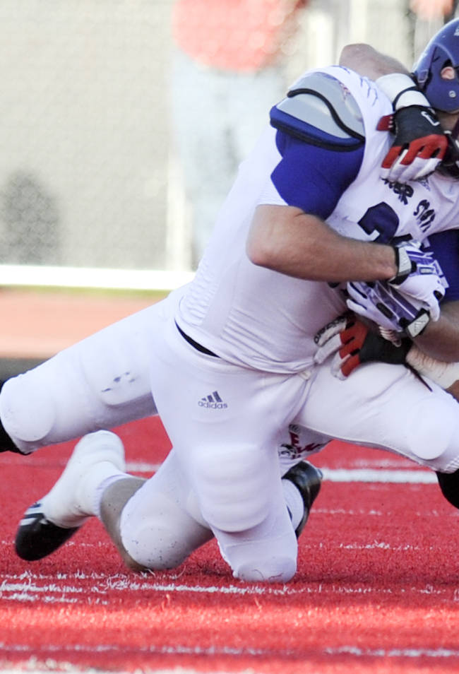 Eastern Washington line backer Cody McCarthy (47) brings down Weber State receiver Cody Raymond (31) during the first half of an NCAA college football game on Saturday, Oct. 5, 2013, at Roos Field in Cheney, Wash