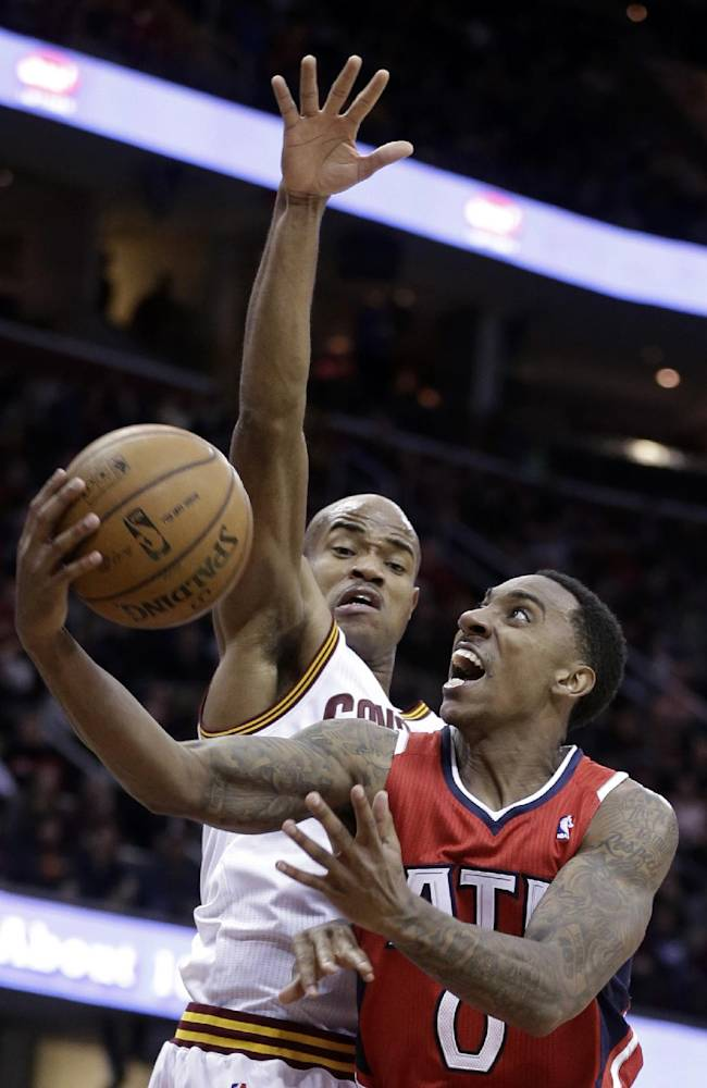 Atlanta Hawks' Jeff Teague jumps to the basket against Cleveland Cavaliers' Jarrett Jack during the third quarter of an NBA basketball game Thursday, Dec. 26, 2013, in Cleveland. Atlanta defeated Cleveland 127-125 in double overtime