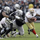 San Francisco 49ers running back Frank Gore (21) runs against the Oakland Raiders during the third quarter of an NFL football game in Oakland, Calif., Sunday, Dec. 7, 2014 The Associated Press