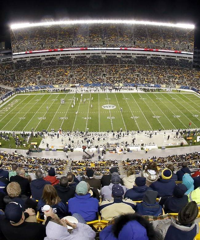 In this photo made with a fisheye lens, Pittsburgh takes on Notre Dame in an NCAA college football game on the playing surface as fans watch at Heinz Field  on Saturday, Nov. 9, 2013, in Pittsburgh. Pittsburgh won 28-21