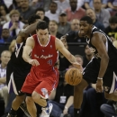 Los Angeles Clippers guard J.J. Redick, left, comes up with the loose ball against Sacramento Kings forward Jason Thompson during the first quarter of an NBA basketball game in Sacramento, Calif., Friday, Nov. 29, 2013 The Associated Press