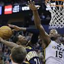 Indiana Pacers' Paul George (24) shoots as Utah Jazz's Derrick Favors (15) defends in the fourth quarter during an NBA basketball game Wednesday, Dec. 4, 2013, in Salt Lake City. The Pacers won 95-86. (AP Photo/Rick Bowmer)