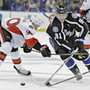 Tampa Bay Lightning center Steven Stamkos (91) cuts by Ottawa Senators right wing Alex Chiasson (90) during the second period of an NHL hockey game Saturday, Nov. 29, 2014, in Tampa, Fla The Associated Press