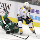 Nashville Predators center Mike Fisher (12) takes control of the puck against Dallas Stars center Cody Eakin (20) during the third period of an NHL hockey game Tuesday, April 8, 2014, in Dallas. The Stars won 3-2 The Associated Press
