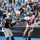 Carolina Panthers' Cam Newton (1) throws a pass over Tampa Bay Buccaneers' Lavonte David (54) in the first half of an NFL football game in Charlotte, N.C., Sunday, Dec. 1, 2013 The Associated Press