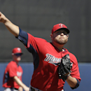 Minnesota Twins pitcher Ricky Nolasco warms up during the second inning of an exhibition baseball game against the Tampa Bay Rays, Sunday, March 2, 2014, in Port Charlotte, Fla The Associated Press
