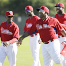 Philadelphia Phillies outfielder Marlon Byrd, right, stretches with teammates during spring training baseball practice on Sunday, Feb. 16, 2014, in Clearwater, Fla The Associated Press