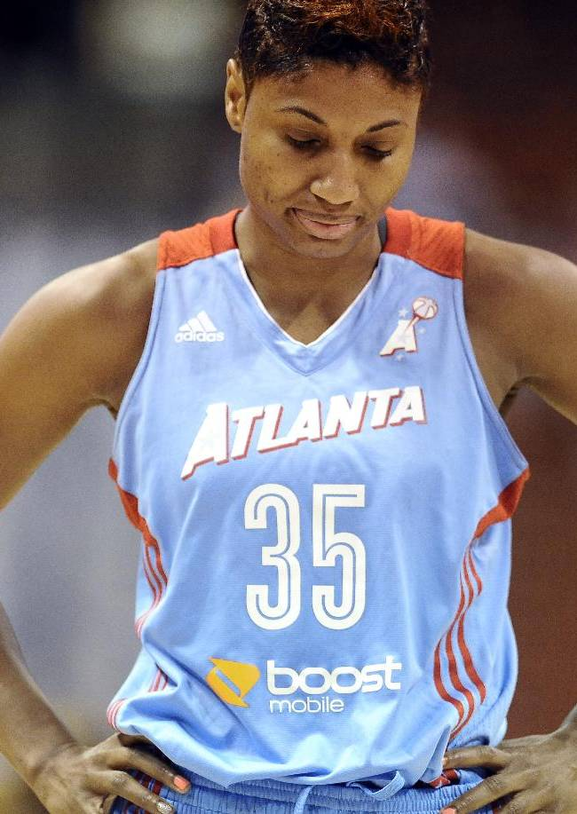 Atlanta Dream's Angel McCoughtry reacts to a foul against her team during the first half of a WNBA basketball game against the Connecticut Sun in Uncasville, Conn., Wednesday, Sept. 11, 2013. Connecticut won 78-77