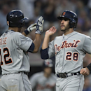 Detroit Tigers' J.D. Martnez, right, is congratulated by teammate Anthony Gose after Martinez scored a one of two runs on a hit by Nick Castellanos in the sixth inning of a baseball game, against the Seattle Mariners Monday, July 6, 2015, in Seattle. (AP Photo/Stephen Brashear)