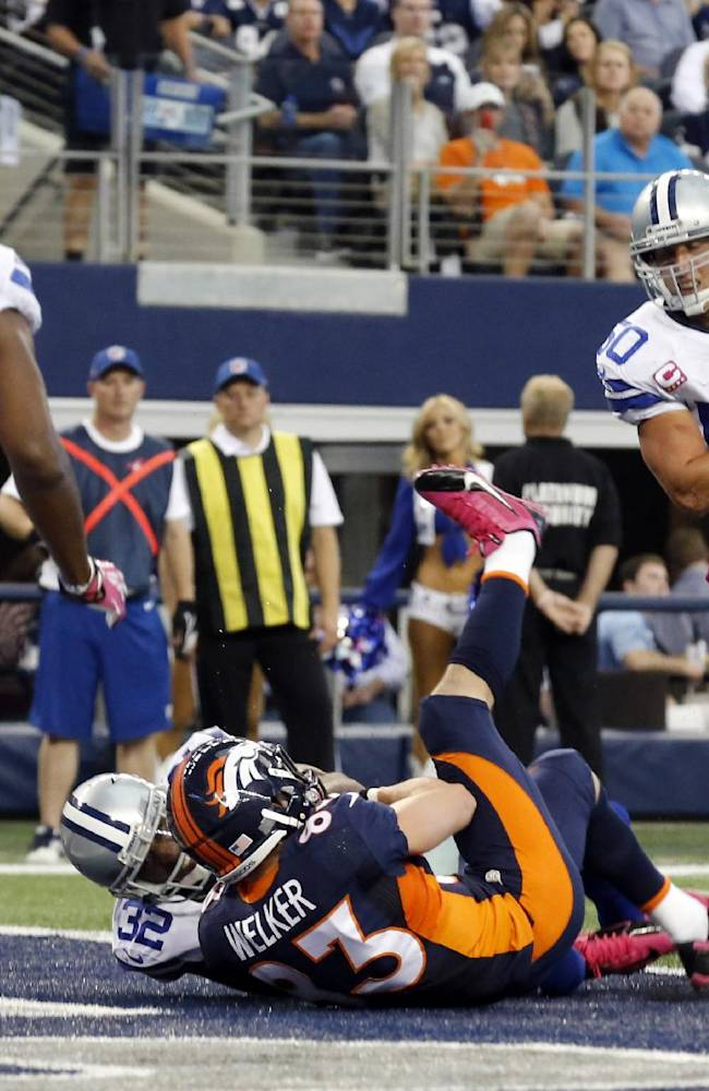 Denver Broncos wide receiver Wes Welker, center right, takes Dallas Cowboys cornerback Orlando Scandrick, center left, into the the end zone for a touchdown during the third quarter of an NFL football game Sunday, Oct. 6, 2013, in Arlington, Texas. Cowboys Barry Church (42) and Sean Lee move in
